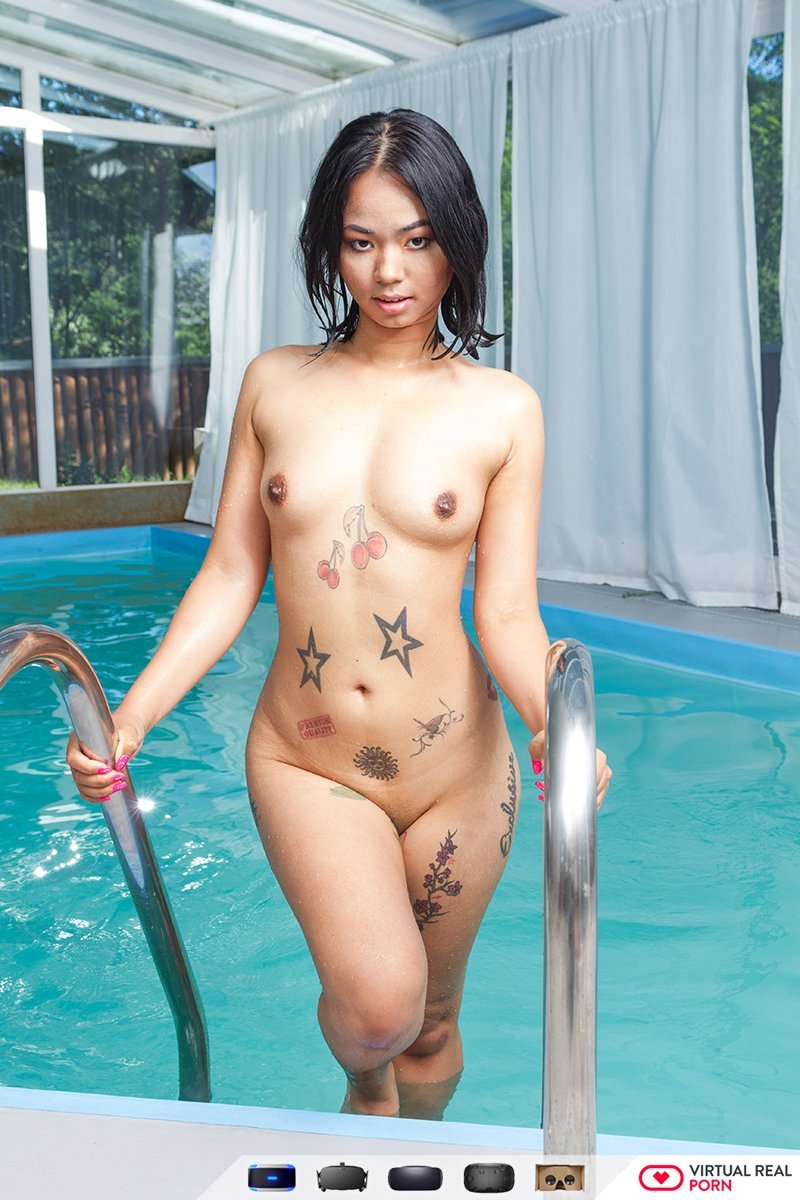 Enjoy watching the tattooed Asian Jureka del Mar play with her shaved and  pierced pussy by the pool in this 180 VR solo girl porn video